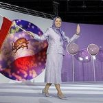 Maryam Rajavi, president-elect of the People's Mujahideen Organisation of Iran's (PMOI) political wing, the National Council of Resistance of Iran (NCRI), holds a former Iranian flag during a rally in Villepinte, near Paris June 18, 2011. REUTERS/Benoit Tessier